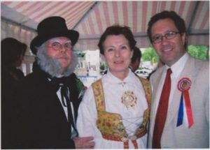 Photo: Berit Hessen With friends, Reidun and Pastor Svein Helge Rødahl of the Norwegian Seamen's Church, on the 17th of May Parade reviewing stand. Rolf, as Ibsen, spoke at the Norwegian Constitution Day celebration, 2006.